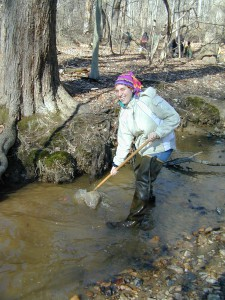 A Stream Wader volunteer using a net to catch critters