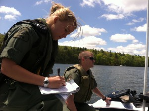 Officers Erica Minnick and Andrew Felsecker check boats for safety equipment on Deep Creek Lake.