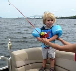 Angler Miles Humphries with his first catch, a white perch from the Key Bridge.