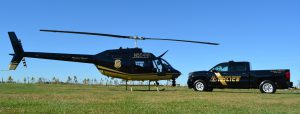 Photo of Maryland Natural Resources Police helicopter and truck