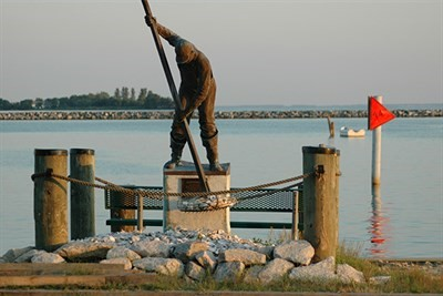 Statue of oysterman on pier in Rock Hall