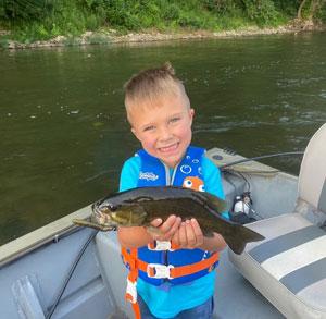 Bennett Henesy with a smallmouth bass on the Potomac River. - Photo by Josh Henesy