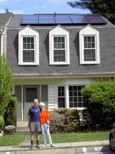 Jim and Sue Russ stand outside their Montgomery County home, which has received an energy efficiency upgrade and had a solar PV array installed.