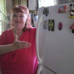 Dottie Fratturelli shows off her more energy efficient refrigerator.